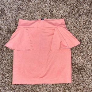 Pink peplum mini skirt